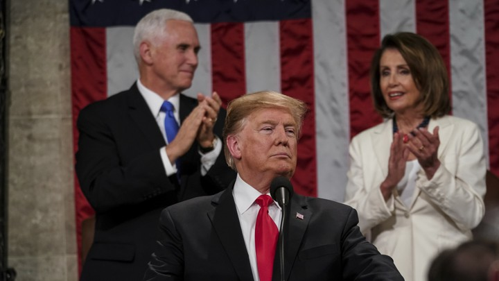 President Donald Trump middle, Vice President Mike Pence, left, and on the right House Speaker Nancy Pelosi