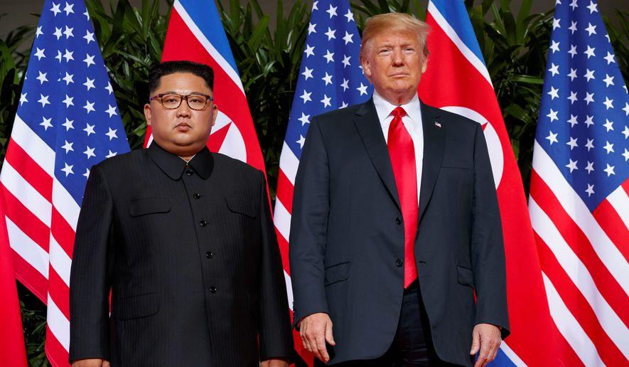 Kim Jung-Un left, President Trump right