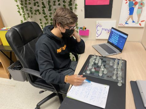 Senior Dom Monacelli researches and studies his chess moves in Independent Study.